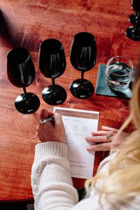 Black wine glasses at Quails' Gate test your tasting ability