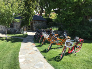 Electric bikes lined up outside a winery on a Chelan tour