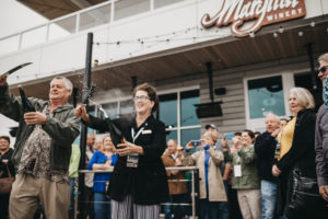 Craig and Vicki Leuthold celebrate opening their tasting room in Vancouver, Washington
