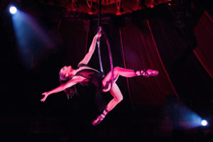 An aerial artist soars in Teatro ZinZanni's Woodinville space